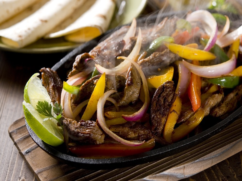 sizzling fajitas on platter