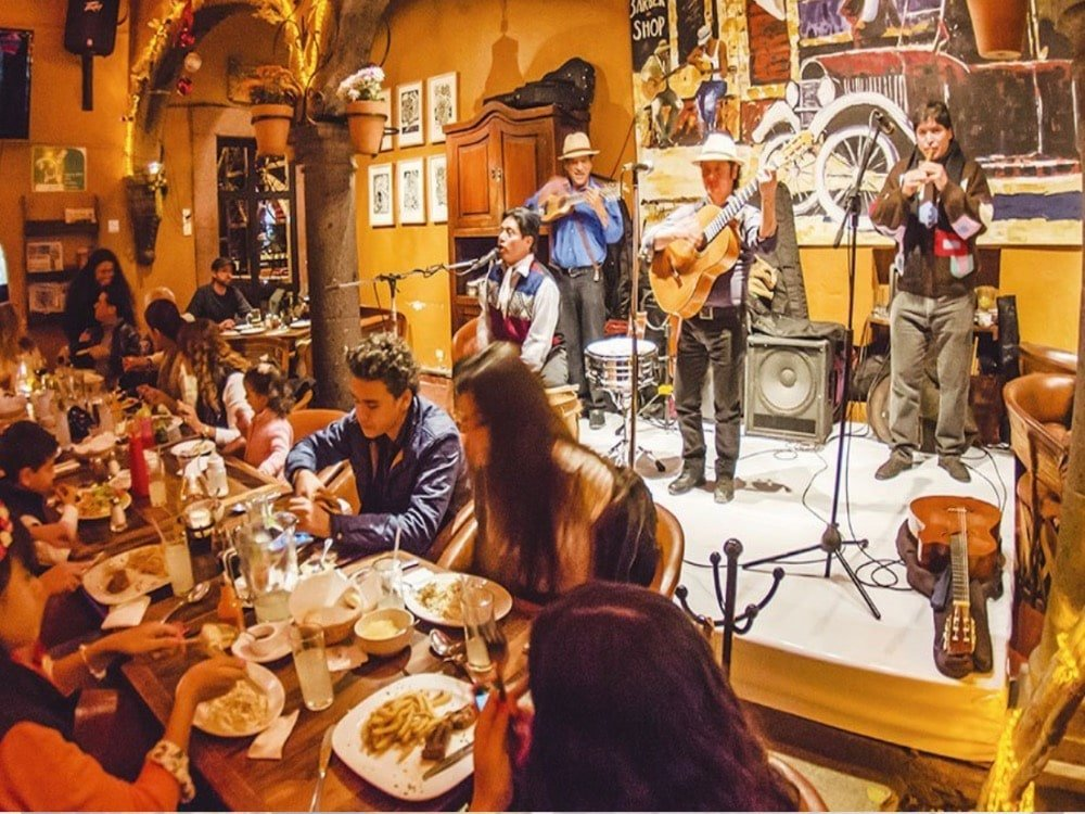 Inside of restaurant Mama Mia with mariachis