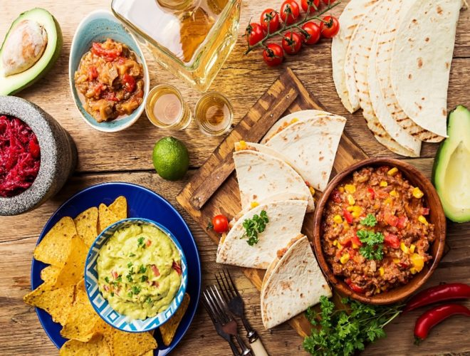 Various different plates of Mexican food