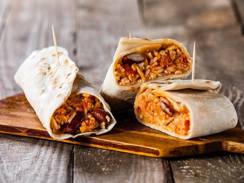 picture of burritos on a wooden board