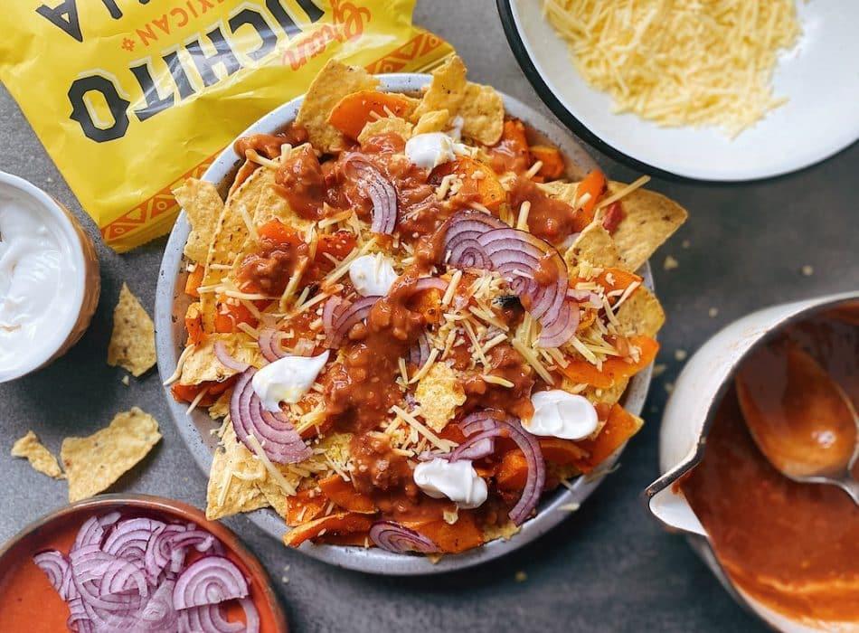 Vegan Nachos building nacho layers