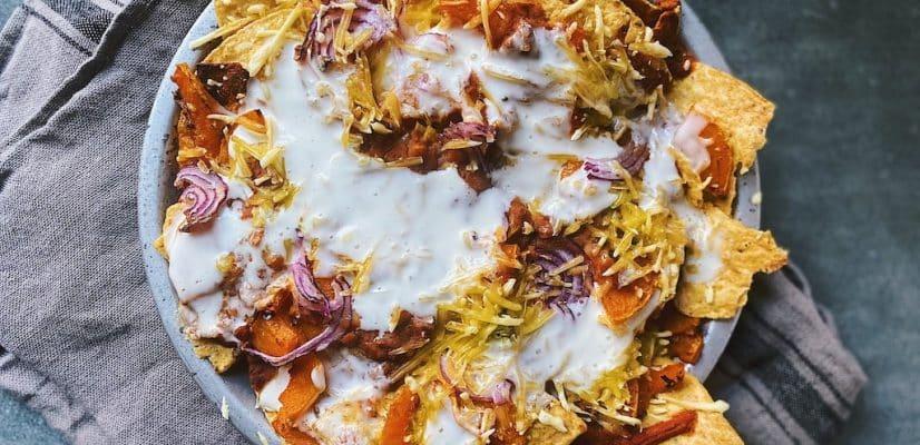 Vegan Nachos prep adding layers of nachos